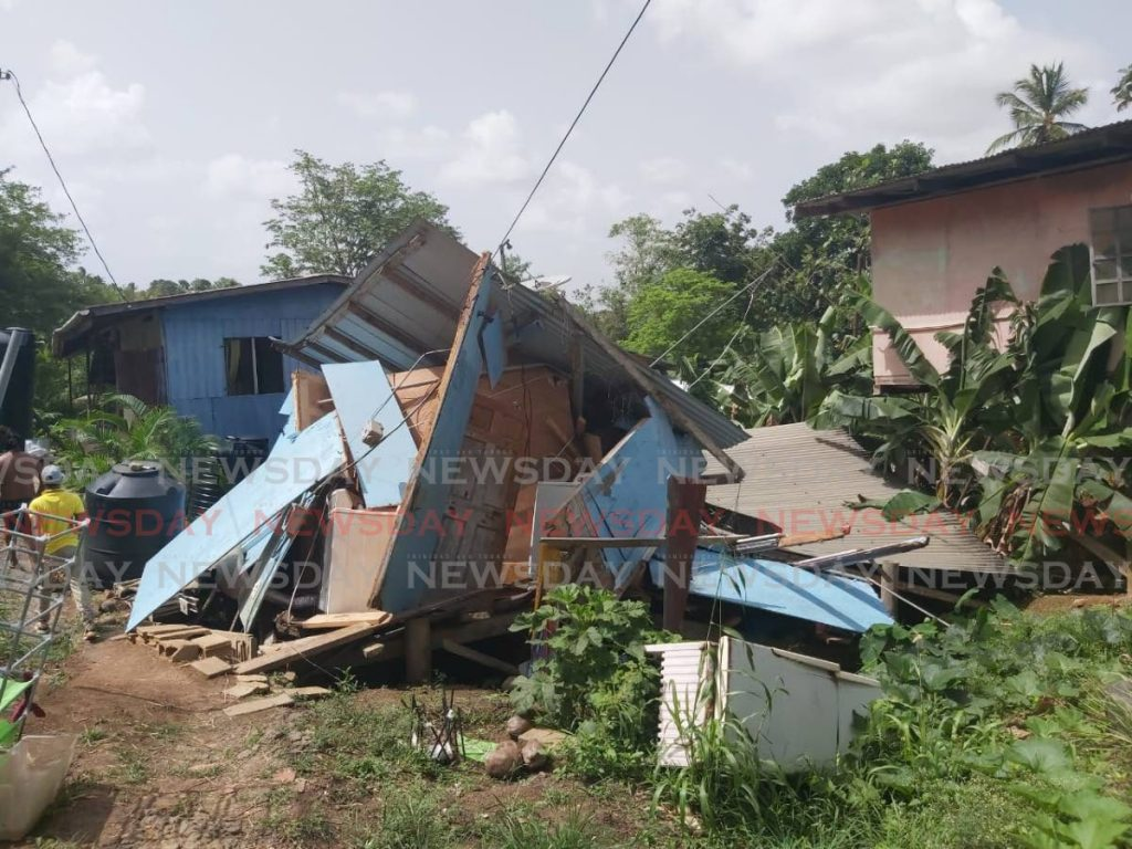 CRASHING DOWN: A landslip in Timital, San Francique led to this house crashing down and leaving a family of five with no place to call home.  -