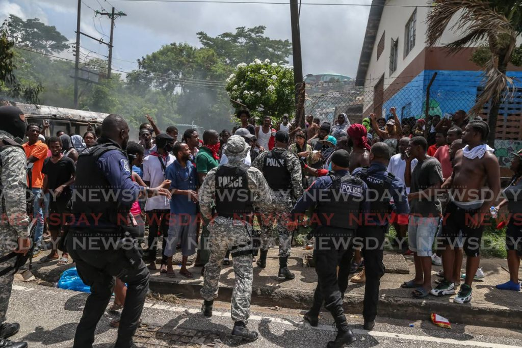 Protesters and police clash during protests in east Port of Spain - Jeff Mayers