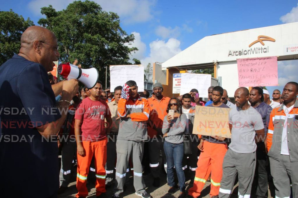 In this 2015 file photo, OWTU president general Ancel Roget speaks to ArcelorMittal steel workers as they  protest in front of the plant in Point Lisas. -