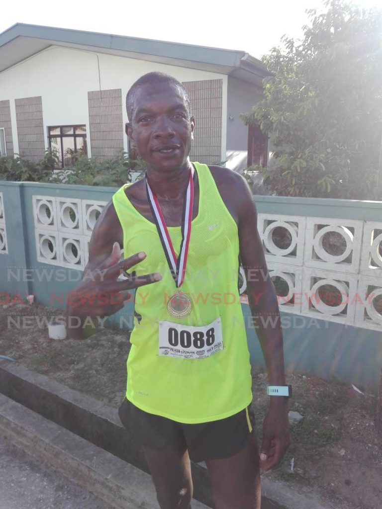 In this August 1, 2019 file photo, Kenyan Alex Ekesa poses with his medal after winning the Freedom Run 5K in Sangre Grande. PHOTO BY STEPHON NICHOLAS - STEPHON NICHOLAS