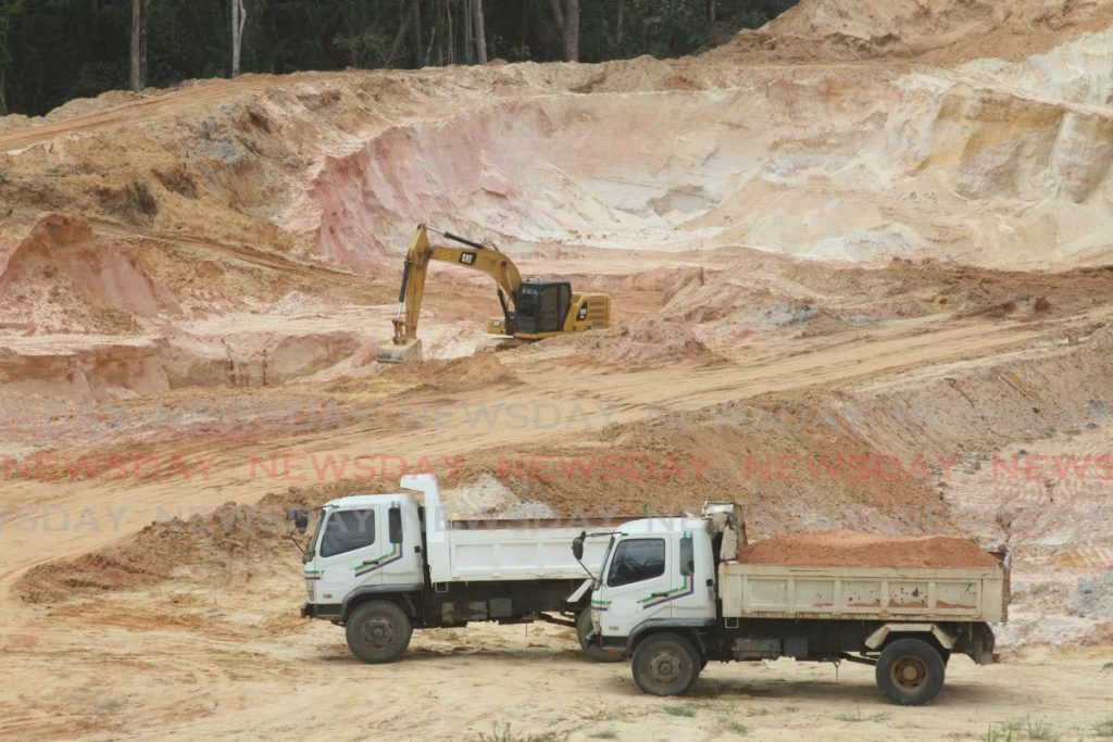 A&A Contracting Company Ltd vehicles at a quarry at Las Lomas #1. Operations was stopped  when police officers visited the site in June. - Angelo Marcelle