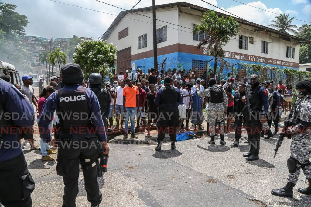 Police keep protesters at bay on the Eastern Main Road in East Port of Spain on June 30 as tempers flared over police killings in Morvant on June 27. - Jeff Mayers