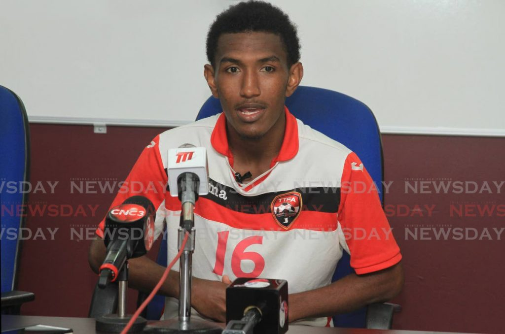 National footballer John Paul Rochford speaks to the media during a press conference at the Police Barracks Ground, St James, on Friday. PHOTO BY AYANNA KINSALE - Ayanna Kinsale