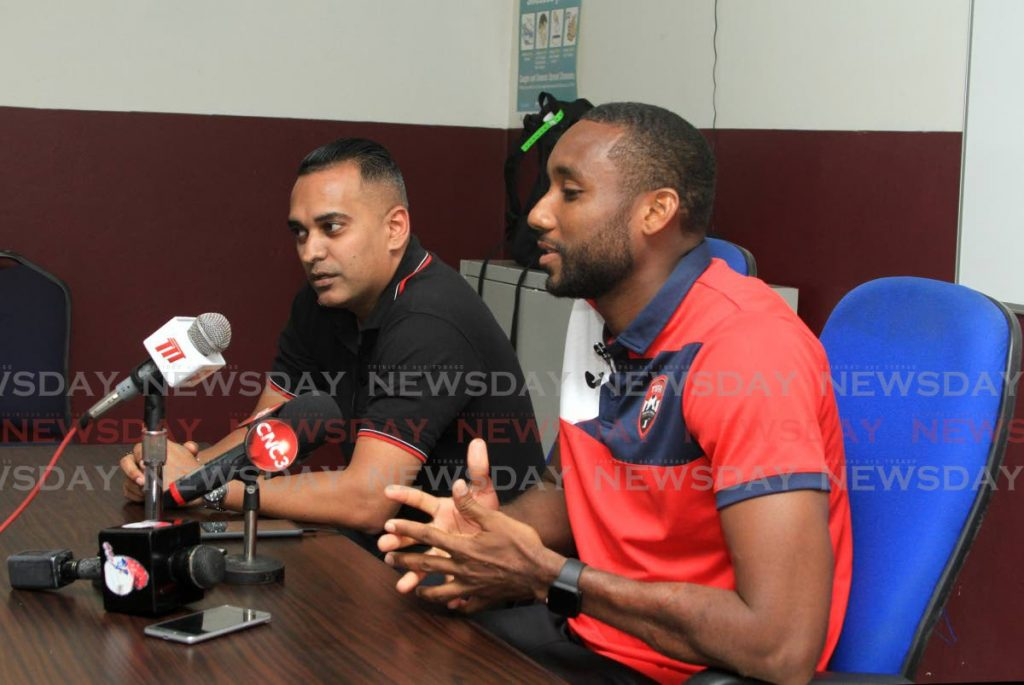 TT footballer Adrian Foncette (right) speaks to the media during a press conference at the Police Grounds, St James on Friday. Also in photo is TTFA communications manager Shaun Fuentes. PHOTO BY AYANNA KINSALE. - Ayanna Kinsale