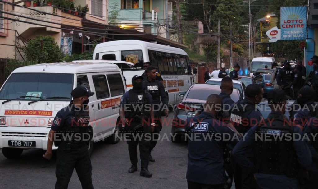 Police officers at the scene in Belmont on Friday where 61 people were arrested for breach of the covid19 regulations. - ROGER JACOB