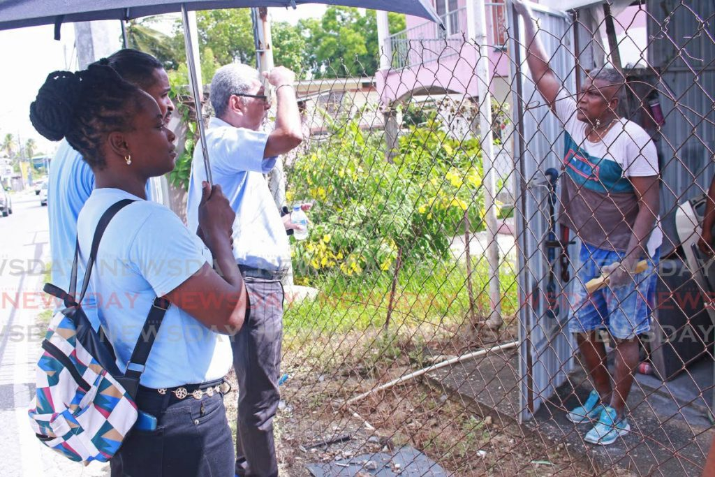 Movement for Social Justice leader David Abdulah, centre, keeps his distance from a resident during his campaign at Union Road, Marabella on Saturday. - CHEQUANA WHEELER