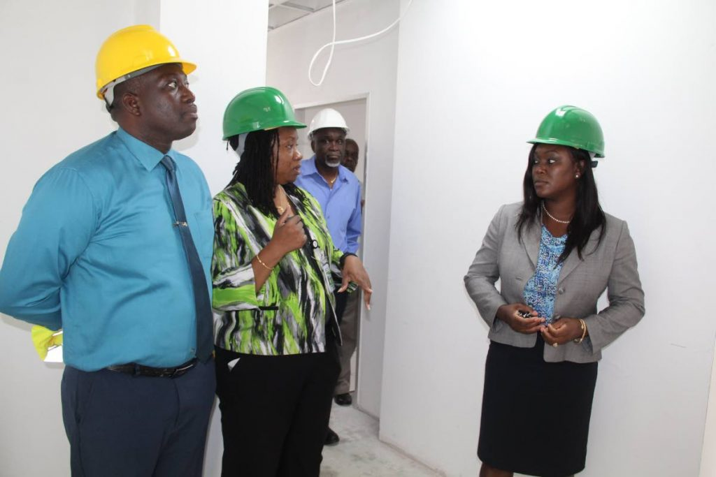 Health Secretary Tracy Davidson-Celestine, right, on a recent tour of the almost completed Moriah Health Centre with officials from Udecott and TRHA.  PHOTO COURTESY THA - THA