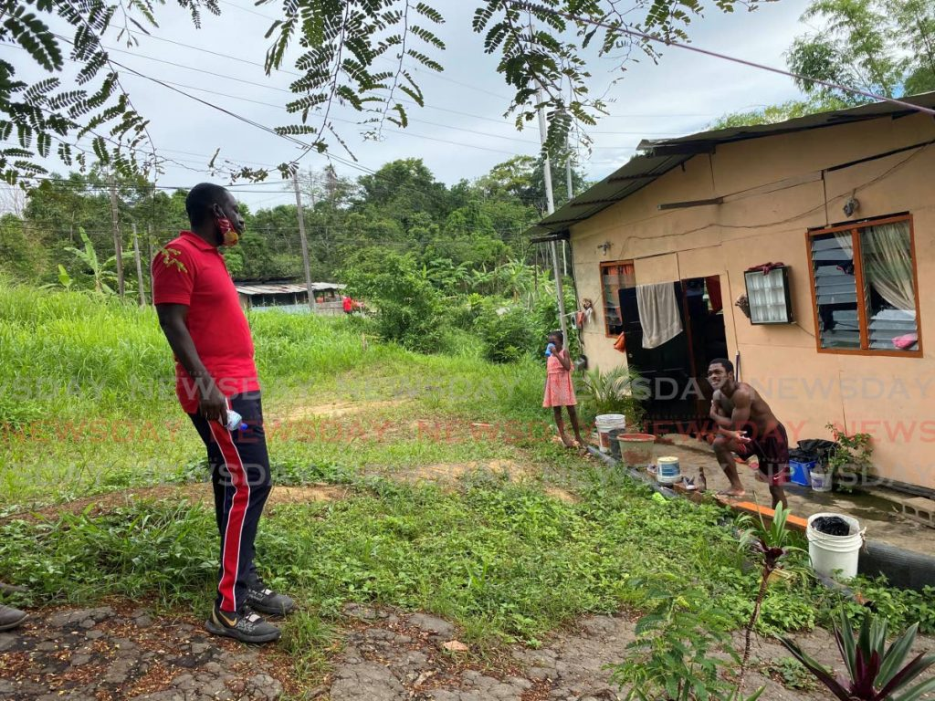 Point Fortin mayor and PNM candidate Kennedy Richards Jr speaks with a resident during a walkabout in Cochrane Village, Guapo in Point Fortin in July. - Narissa Fraser