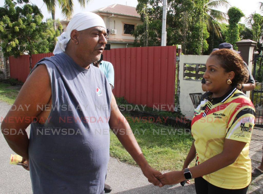 UNC general election candidate for Tabaquite Anita Haynes speaks to a constituent during a walkabout on Charles Street, Gasparillo, on Wednesday. - Vashti Singh