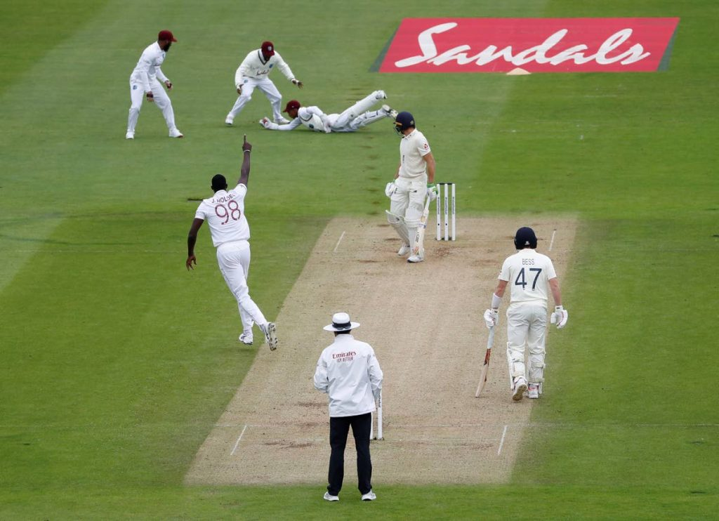 West Indies' wicketkeeper Shane Dowrich dives to take the catch to dismiss England's Joss Buttler, second right, off Jason Holder during the second day of the first cricket Test match between England and West Indies, at the Ageas Bowl in Southampton, England, on Thursday. (AP PHOTO) -