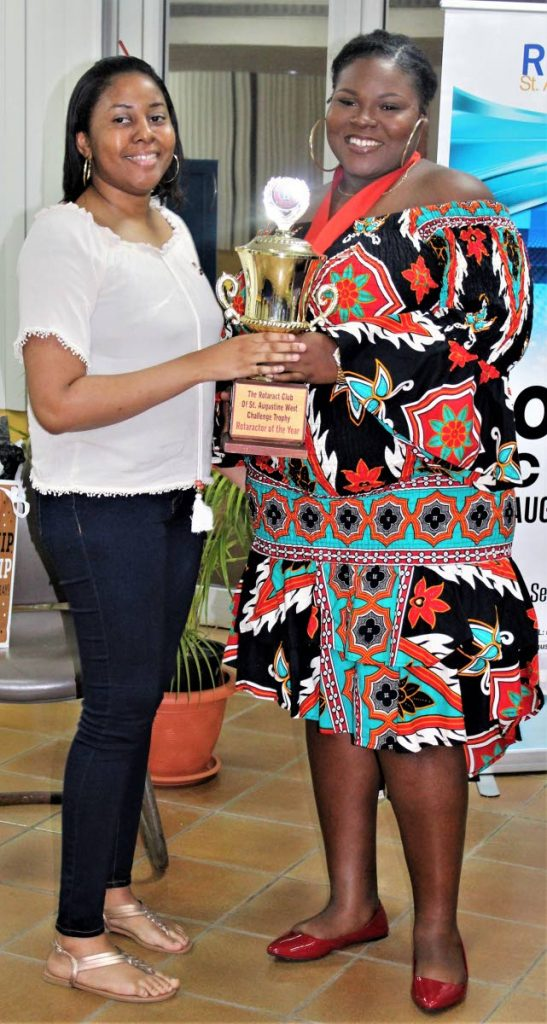 Khandace Yorke-Ventor receives her award for Rotaract of the Year from Linda Ashby. -