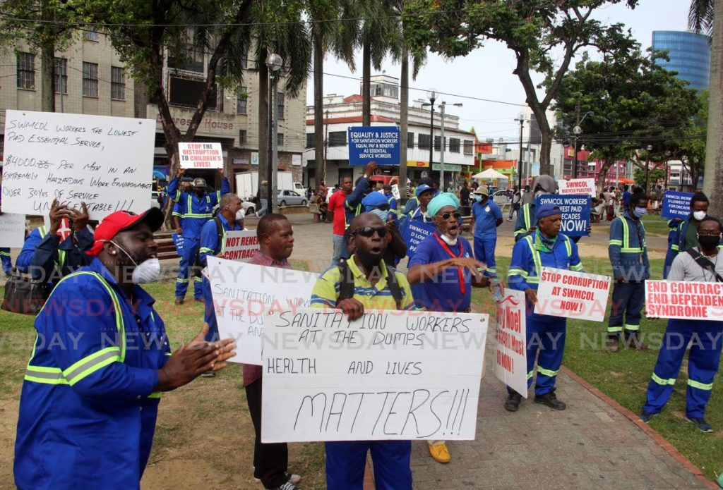 SWMCOL workers protest outside the company's head office at Independence Square, Port of Spain on Friday. PHOTO BY SUREASH CHOLAI -