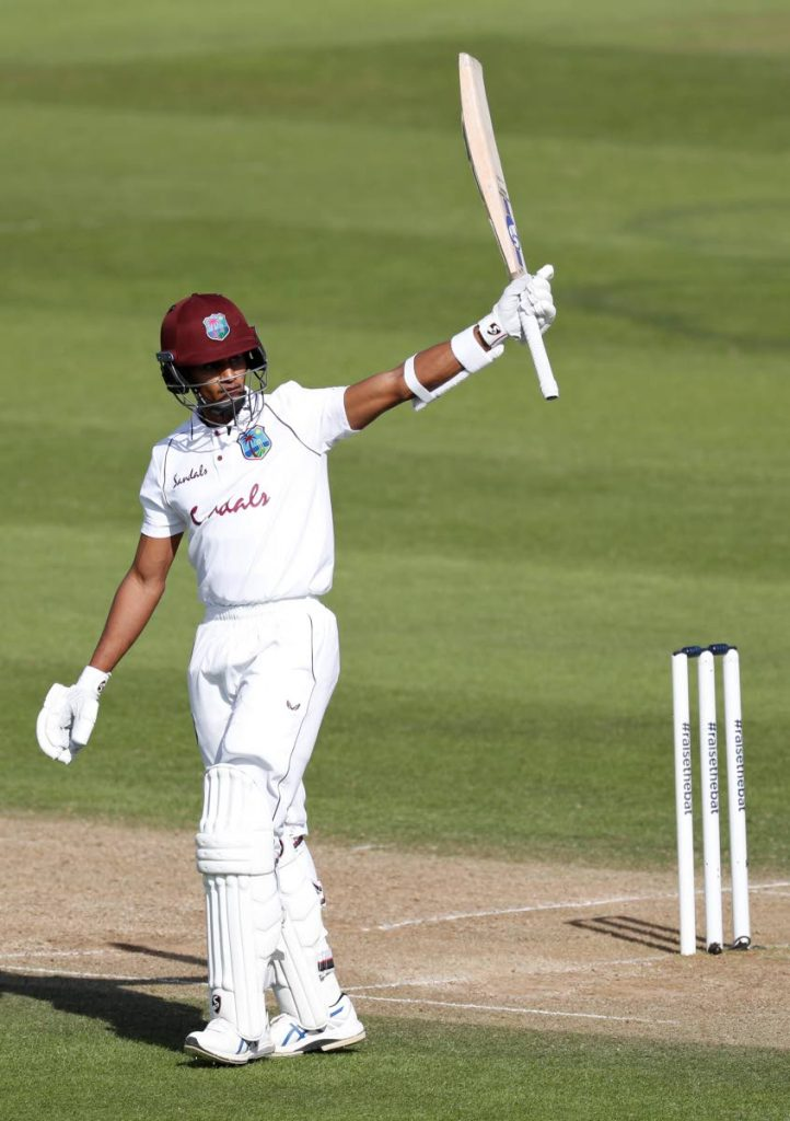 West Indies' Shane Dowrich raises his bat to celebrate his half-century during the third day of the first cricket Test match between England and West Indies, at the Ageas Bowl in Southampton, England, on Friday. (AP PHOTO) -