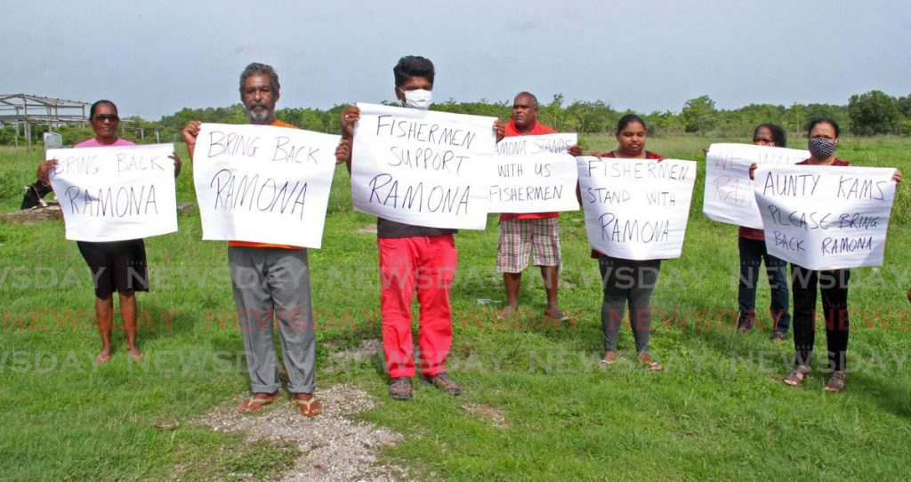 Orange Valley protesters ask UNC leader Kamla Persad-Bissessar to bring back the outgoing Couva North MP Ramona Ramdial in a small demonstration on Friday. - Vashti Singh