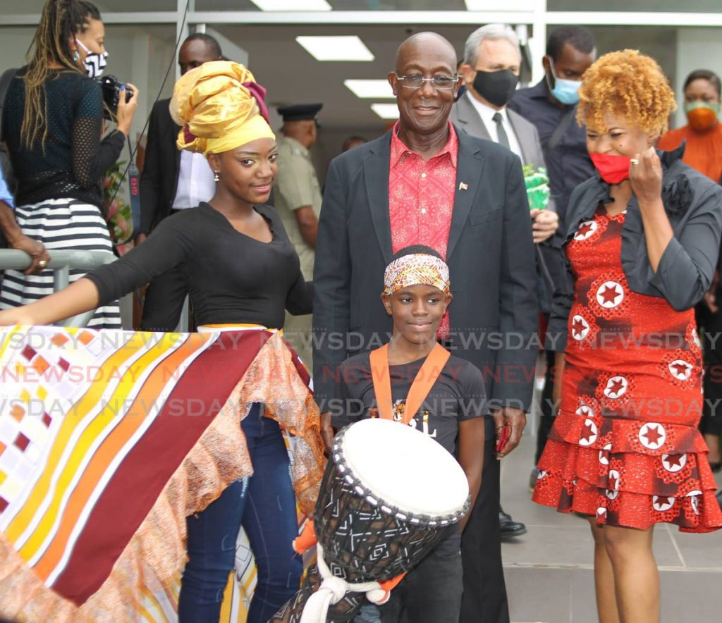 From left: Dancer Elizabeth McDonald of Bagatelle Angels Dance Group, Prime Minister Dr Keith Rowley, drummer Isaiah Cooper, and Minister of Community Development, Culture and the Arts Dr Nyan Gadsby-Dolly at the opening of the Bagatelle Community Centre in Diego Martin on Friday. - ROGER JACOB