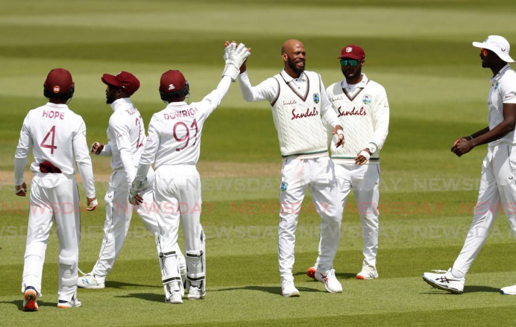 West Indies' Roston Chase, third right, celebrates with team-mates the dismissal of England's Rory Burns during the fourth day of the first Test match between England and West Indies, at the Ageas Bowl in Southampton, England, on Saturday. (via AP) -