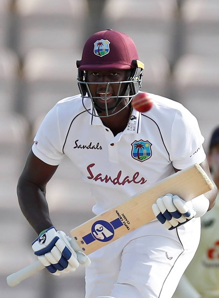 West Indies captain Jason Holder reacts after playing a shot during the fifth day of the first Test match between England and West Indies, at the Ageas Bowl in Southampton, England, on Sunday. (via AP) -