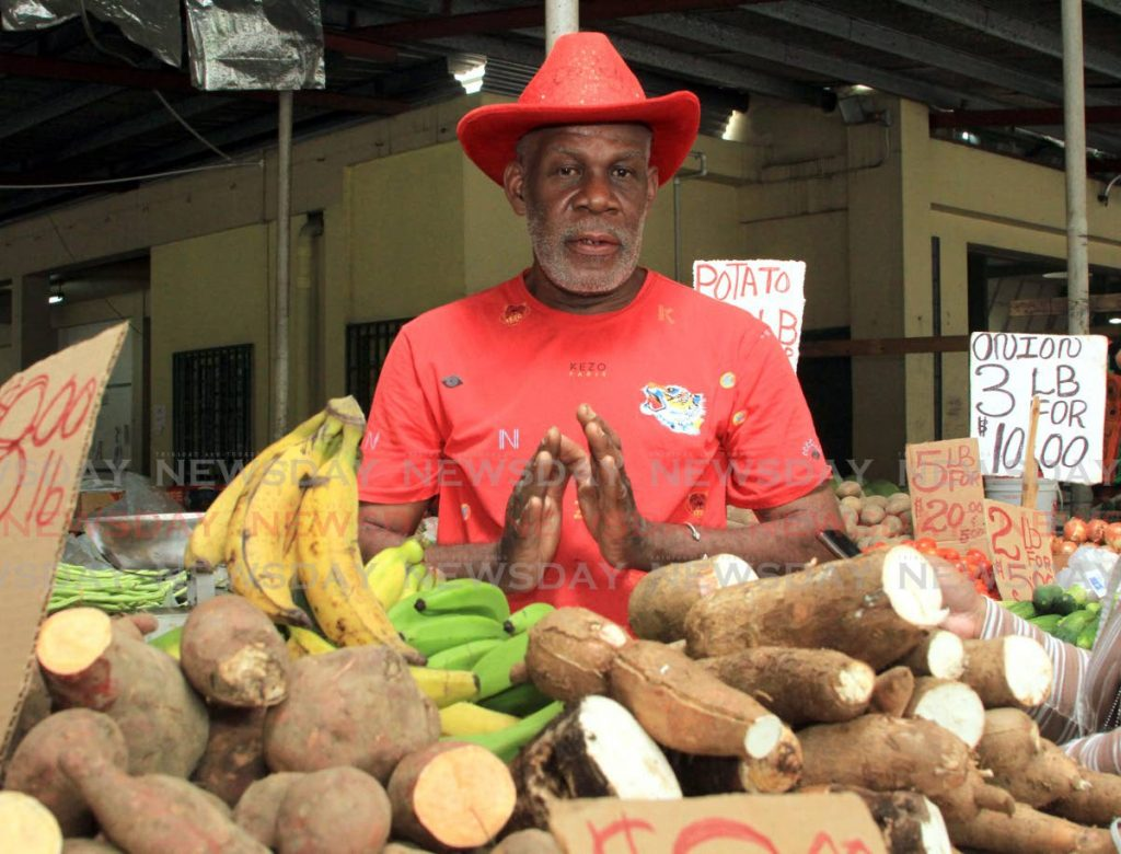 Vendor Roland Wills speaks about his representative Prakash Ramadhar at the Tunapuna Market. - Ayanna Kinsale