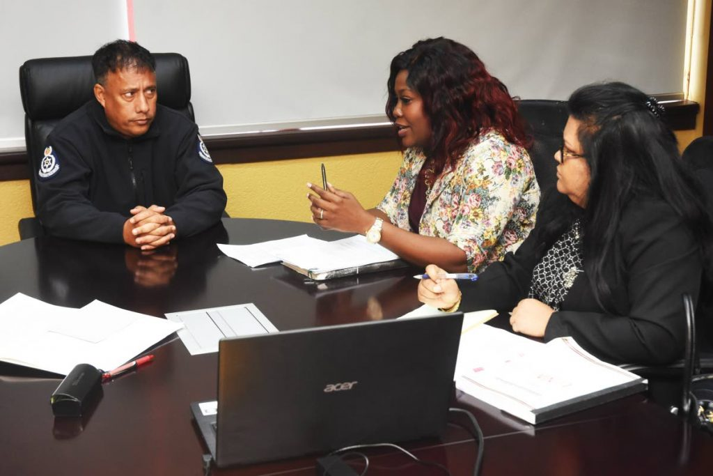 Police Commissioner Gary Griffith during his meeting with Chief Elections Officer Fern Narcis-Scope and deputy Chief Elections Officer Lena Sahadeo at Police Administration Building in Port of Spain on July 14. Griffith on Saturday said political parties must get police permission to use music trucks and for motorcades during the election campaign. PHOTO COURTESY TTPS -