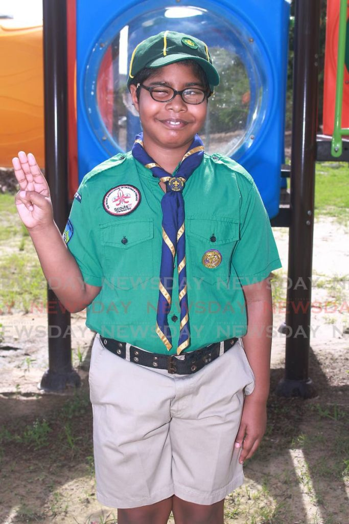Kiran Lall takes his oath as a Cub Scout very seriously.  -