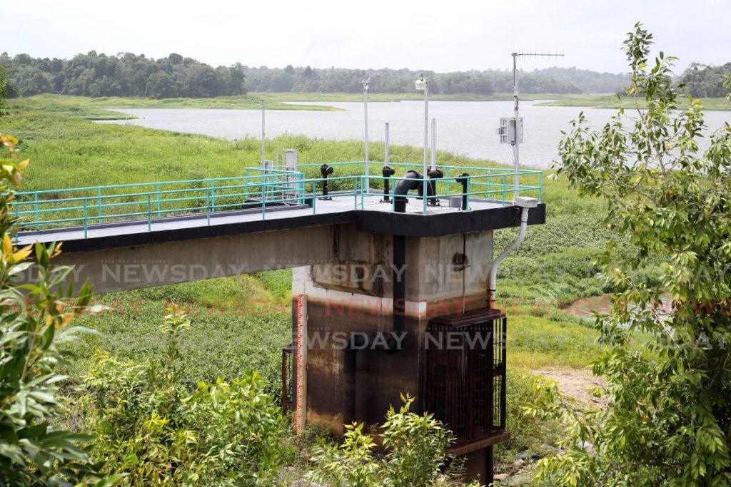 The view of the main valve tower at the Water and Sewerage Authority's Arena Reservoir, surrounded by vegetation showing extremely low water levels. - ROGER JACOB