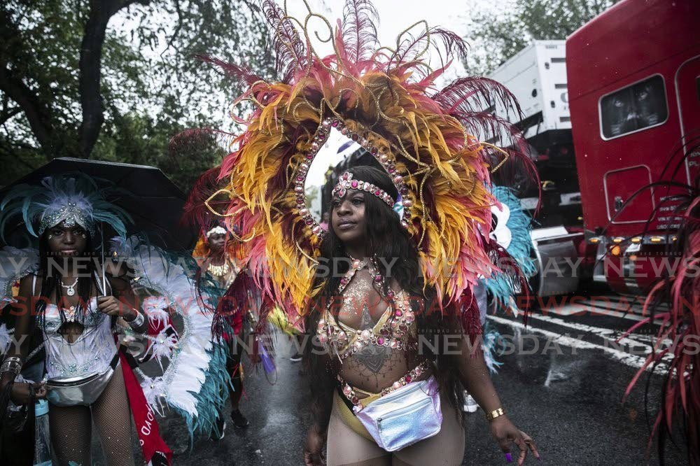 Revellers participate IN the West Indian American Day Parade in the Brooklyn borough of New York, on September 2, 2019. - AP Photo