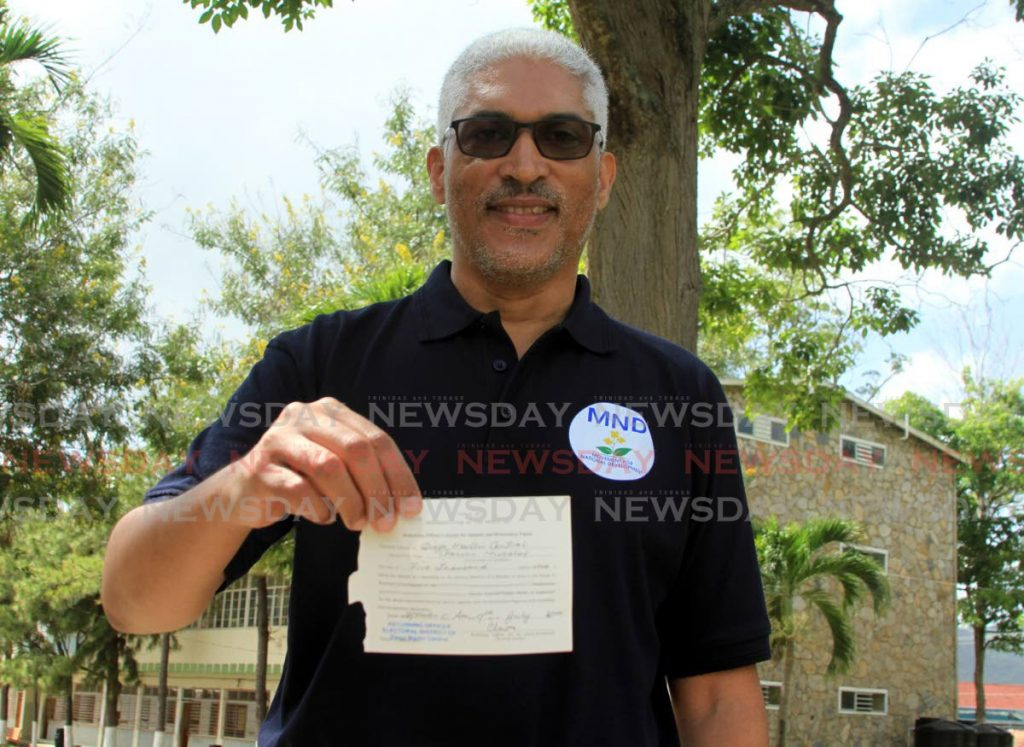 Leader of the Movement for National Development Garvin Nicholas shows his nomination slip after filing at the Diego Martin Central Secondary School. - Ayanna Kinsale