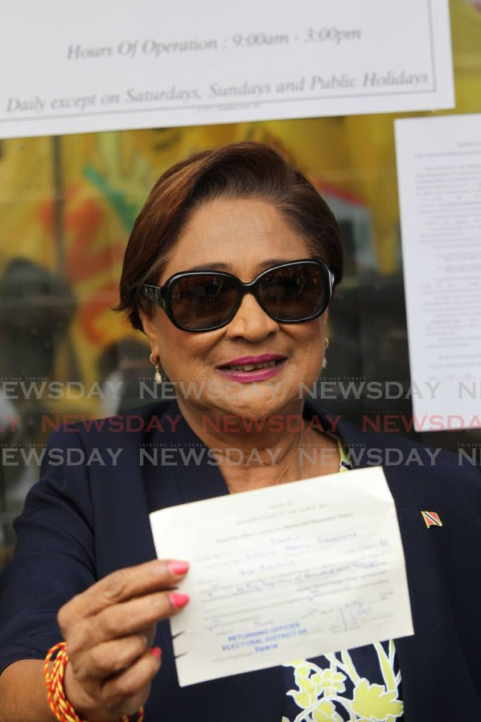 Political leader of the UNC Kamla Persad Bissessar showing her receipt after  filing her nomination papers at the Elections and Boundaries office in Penal for the upcomming General Elections on August 10.   Lincoln Holder / NEWSDAY      - Lincoln Holder