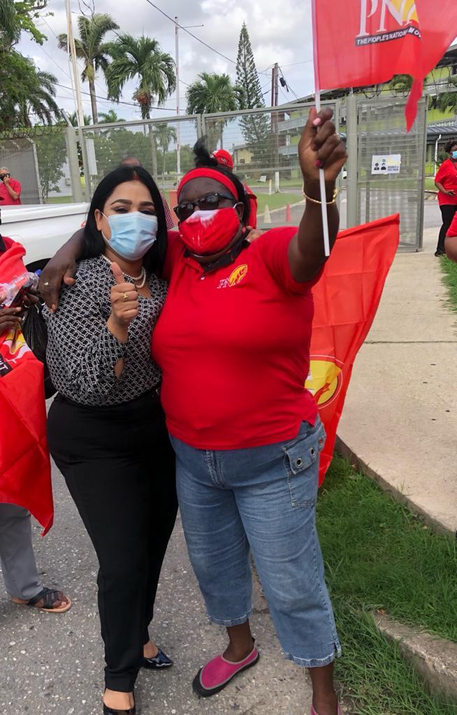 Photo of Renuka Sagramsingh-Sooklal after filing her nomination papers to become the PNM candidate for St Augustine, joined by her supporter.