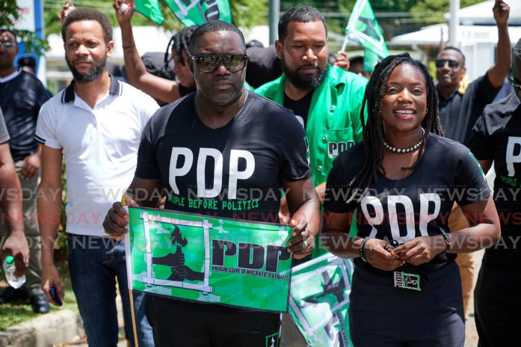 PDP leader and Tobago East candidate Watson Duke escorts the party's Tobago West candidate Tashia Grace Burris to file her nomination papers at Calder Hall Multipurpose Facility, Calder Hall on Friday. PHOTO BY LEEANDRO NORAY -