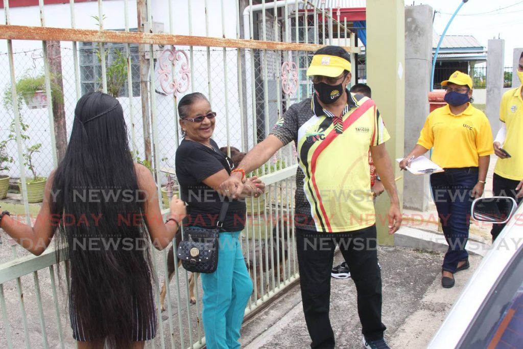 UNC Oropouche West candidate Dave Tancoo greets residents during a walkabout in La Fortune, La Romaine on Saturday. PHOTO BY LINCOLN HOLDER -
