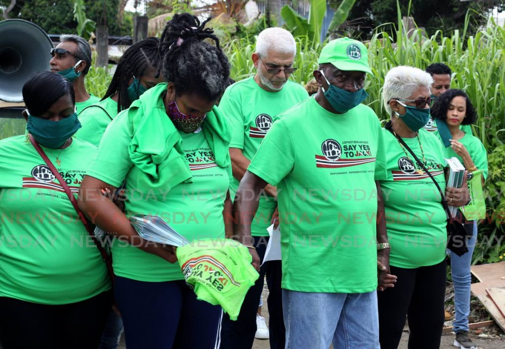 ILP leader and Lopinot/Bon Air candidate Jack Warner prays with supporters at Thavenot Street, Tacarigua before going on a walkabout on Saturday. PHOTO BY ROGER JACOB -