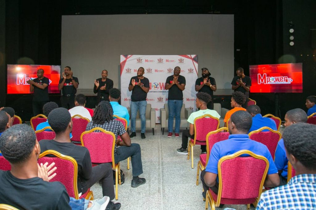 Masters applaud young men in attendance at the last MPower TT MZone session titled Parenting, fatherhood and mentoring at the Creative Arts Centre, San Fernando on March 12.  Photo courtesy Kerron Savory -