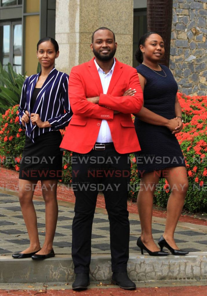 CEO of CtrlAltFixed Tech Ishmael Moreno takes a photo with Chief Information Officer Kafra Morris, left, and Chief Operations Officer Shanice Dick at the HYATT Regency, Port of Spain.  - Ayanna Kinsale