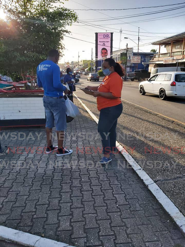 PEP candidate for Point Fortin Kenesha Ramsoondar speaks with a constituent during a walkabout. Photo via PEP Point Fortin Facebook page.  -