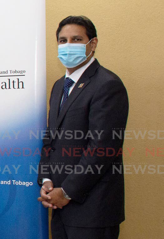Chief Medical Officer Dr Roshan Parasram wears a mask during a recent handing over ceremony at the Ministry of Health. -