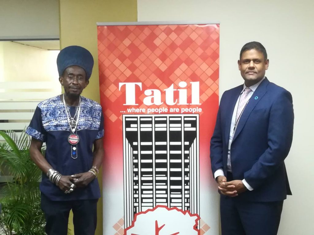 Lutalo Masimba, president of  TUCO, left and Musa M Ibrahim, managing director,  TATIL at the signing of the health insurance plan. -