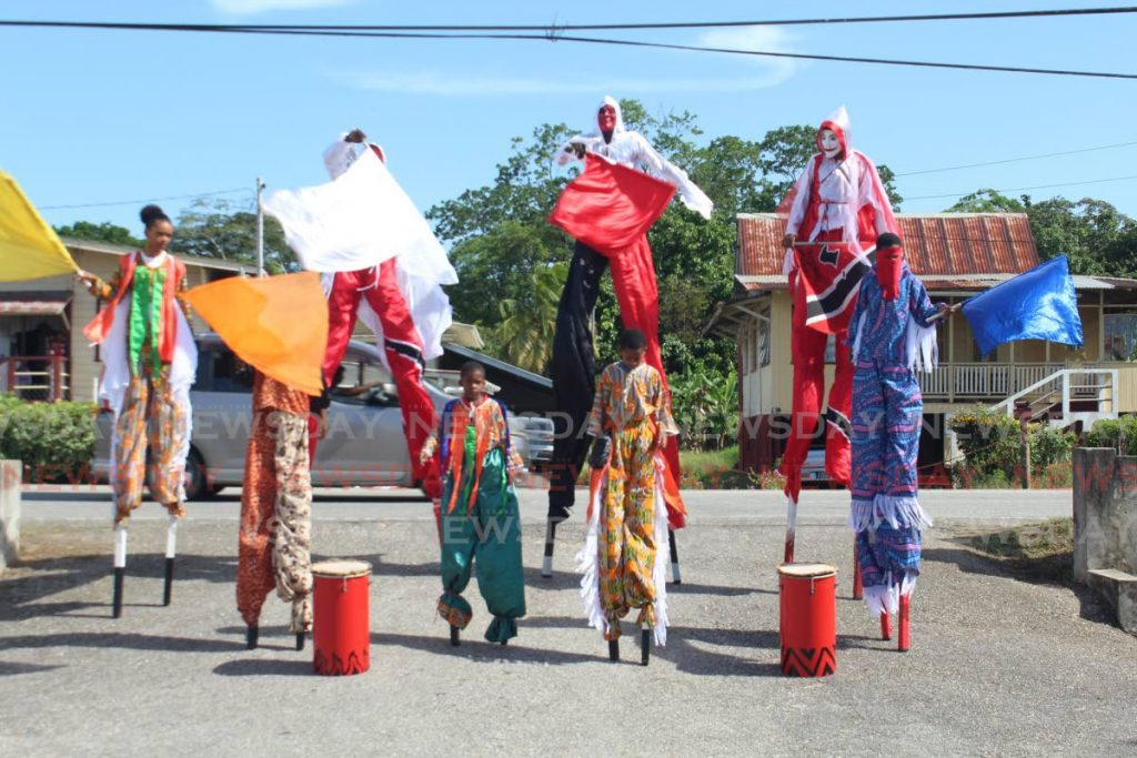 Brothers Road Empowerment group show off their Moko Jumbies as part of an EPIC project where youth are trained to create the traditional art form in the New Grant community. - Digicel Foundation