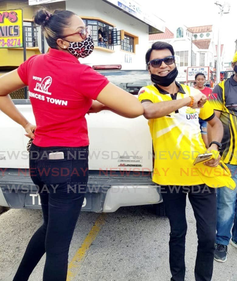 OPPOSING ELBOWS: UNC general election candidate for Princes Town Barry Padarath posted this photo on his Facebook page showing him greeting PNM candidate for that constituency, Sharon Baboolal, during a campaign walkabout.  -