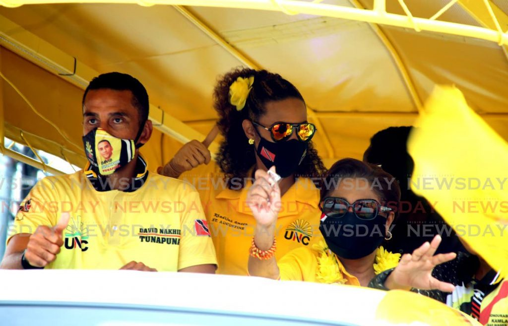 UNC political leader Kamla Persad Bissessar, right, joins Tunapuna candidate David Nakhid, left, and St Augustine candidate Khadija Ameen, centre, for a motorcade on Tuesday. - Sureash Cholai