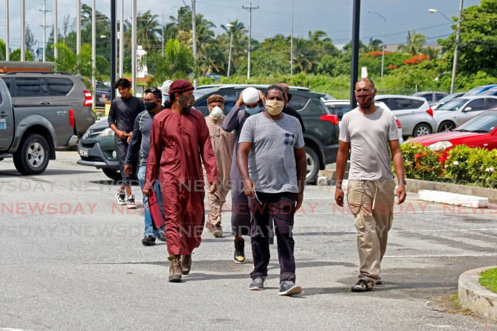 Rice farmers leave the Ministry of Agriculture, Land and Fisheries after meeting with permanent secretary Susan Shurland on Thursday morning.  PHOTO BY MARVIN HAMILTON -