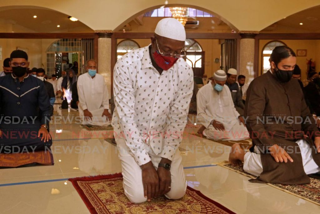 Prime Minister Dr Keith Rowley prays at the San Fernando Jama Masjid on Friday as he joined the Muslim community in observing the start of Eid al-Adha.  - Marvin Hamilton