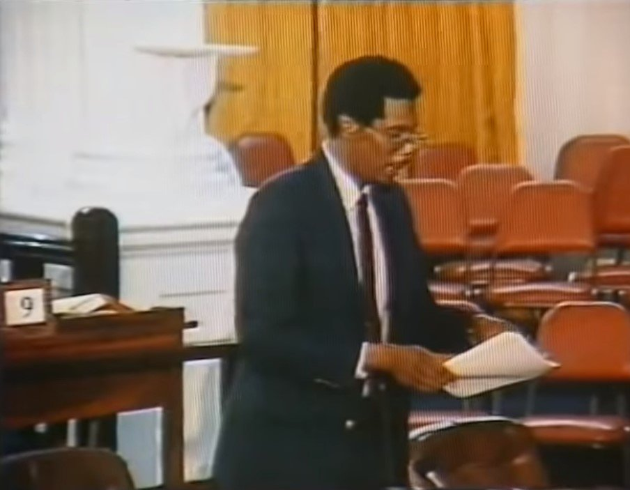 WHO'S YOUR LEADER?: A freeze-frame taken from a YouTube video shows Govt Minister Joseph Toney in Parliament on July 27, 1990. As he asked,
