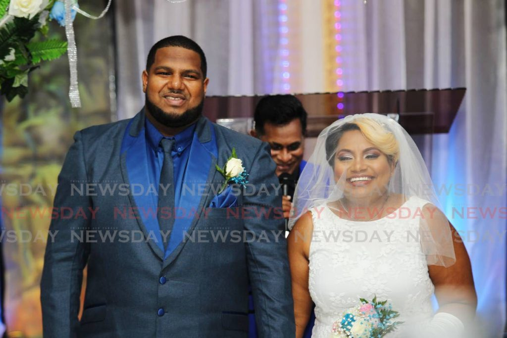 Stacyann Bisoon and Andy Edwards after their wedding at House of Mercy Church, Marabella on Saturday evening. PHOTO BY LINCOLN HOLDER -