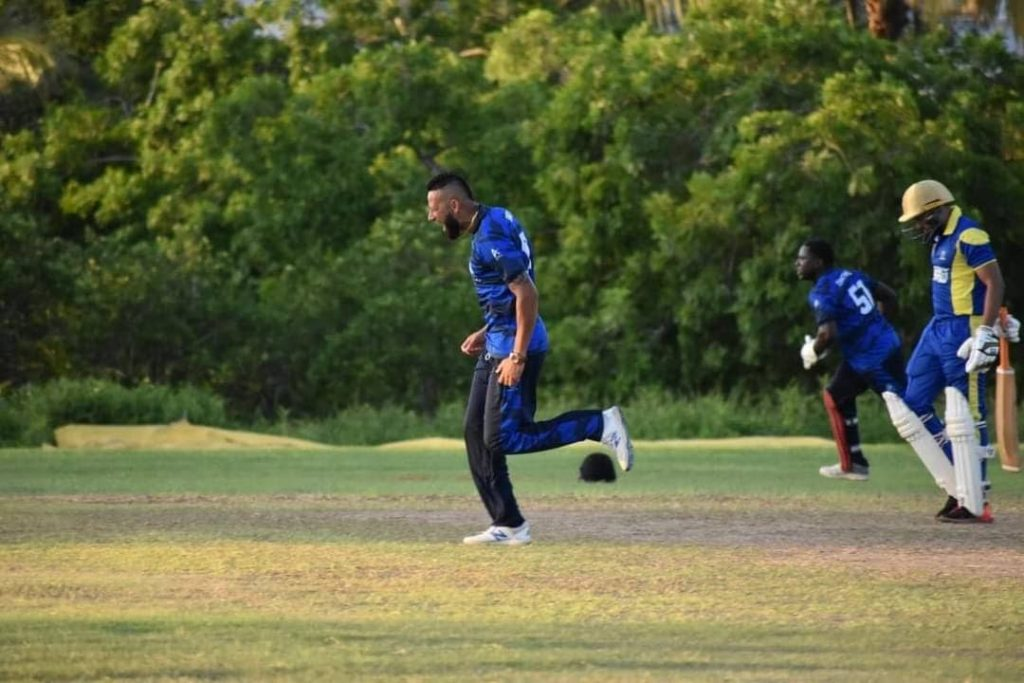 Police Cricket team bowler Rayad Emrit celebrates after getting the wicket of Amir Jangoo caught behind by Brian Christmas for one. PHOTO COURTESY CSL - CSL