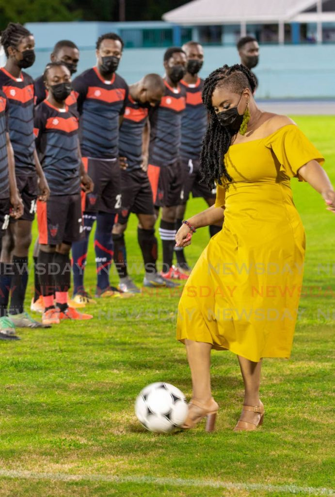 Sports Minister Shamfa Cudjoe kicks the ball ahead of an exhibition game between Bethel United FC and Canaan/1976 FC Phoenix at the newly reopened Dwight Yorke Stadium in Bacolet on Saturday. PHOTOS BY DAVID REID -