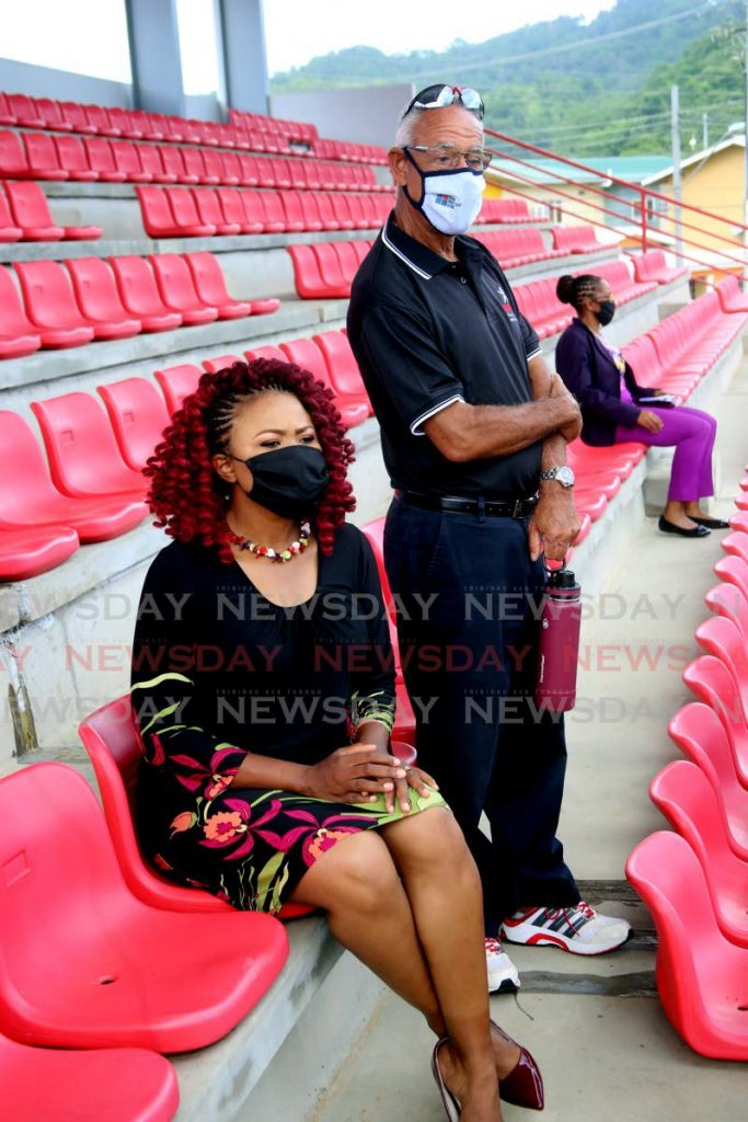 SporTT chairman Douglas Camacho (standing) and former St Ann's East MP Dr Nyan Gadsby-Dolly at the newly refurbished pavilion during Tuesday's reopening of the Brian Lara Recreation Ground in Santa Cruz. PHOTO BY SUREASH CHOLAI. - SUREASH CHOLAI