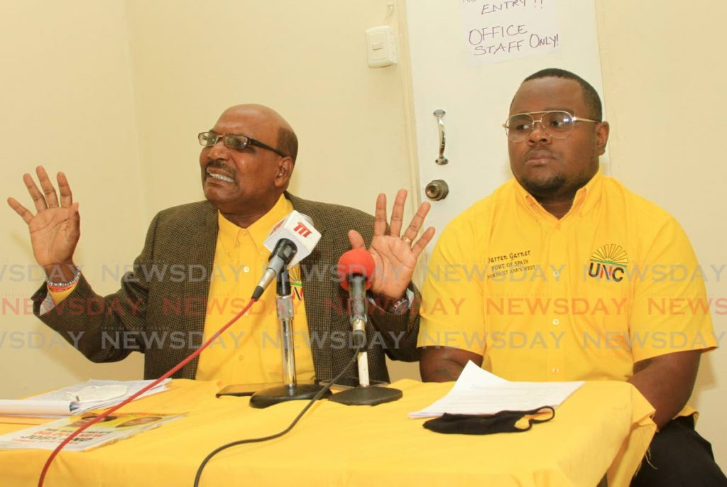 PNM TRICKS: Former UNC senator Wade Mark makes a point on Tuesday during a press conference in Port of Spain in support of the party's PoS North/West candidate Darren Garner, right.   - Ayanna Kinsale