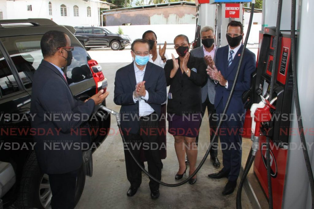 FILLING UP: Energy Minister Franklin Khan, 2nd from left, fuels an SUV on Tuesday during the formal opening of NP's O'Meara station. At Khan's right in the photo is the PNM's D'Abadie/O'Meara candidate and Arima Mayor Lisa Julien-Morris.  - ROGER JACOB