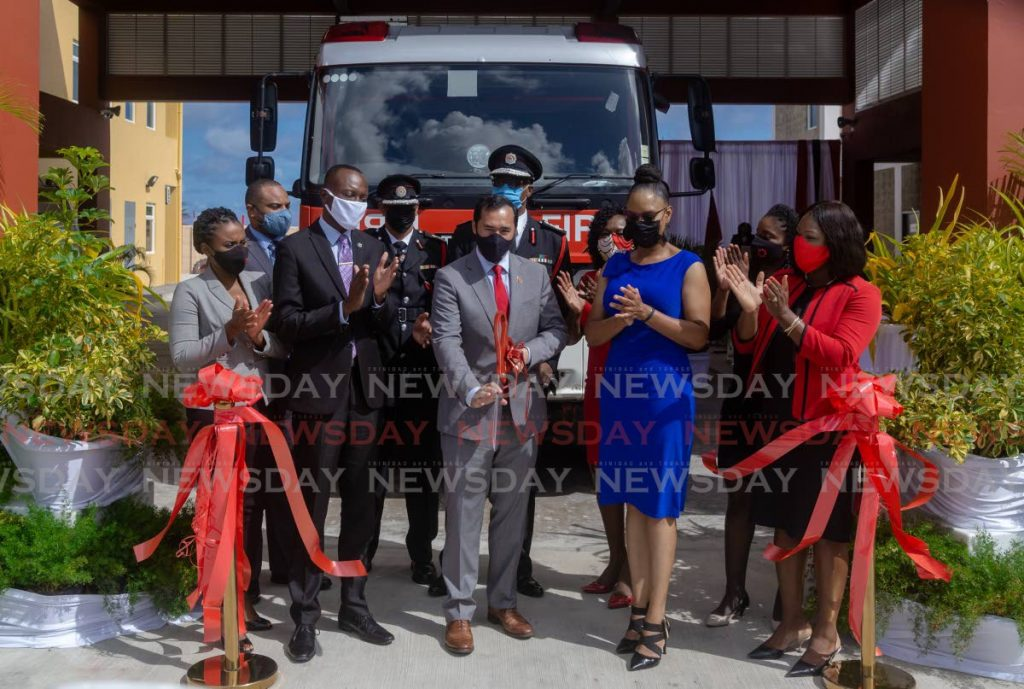 National Security Minister Stuart Young, centre, cuts the ribbon to open the Roxborough Fire Station on Tuesday. Also present at the ceremony were Chief Secretary Ancil Dennis, PNM Tobago East candidate Ayanna Webster-Roy and other officials. PHOTO BY DAVID REID -